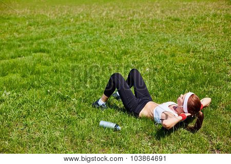 Active girl doing situps in natural environment