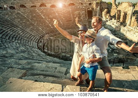 Funny Family Take A Self Photo In Amphitheatre Building.Side,Turkey