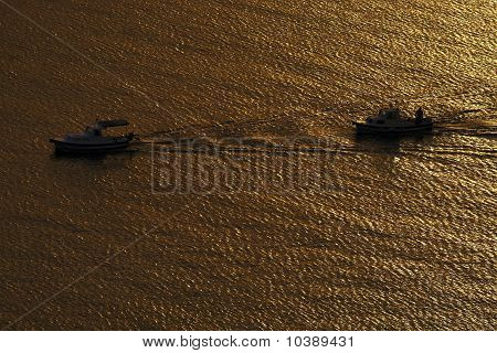 two boats in sunset