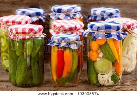 Jars with pickles, tomatoes and chillies