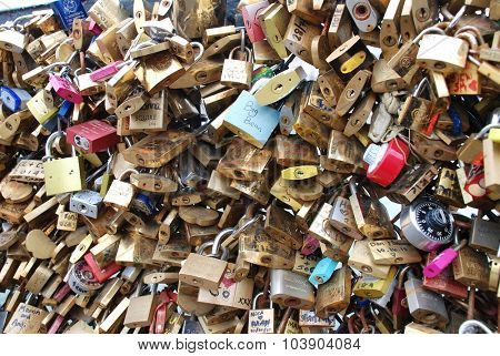 PARIS, FRANCE - MARCH 18, 2014: Padlocks on the Pont de L'Archeveche (Archbishops bridge) over the River Seine. Thousands of lovers attach them as a symbol of eternal love.