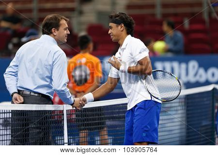 KUALA LUMPUR, MALAYSIA - SEPTEMBER 26, 2015: Syed Mohd Agil of Malaysia greets the umpire in his qualifying match in the Malaysian Open 2015 Tennis tournament held at the Putra Stadium, Malaysia.