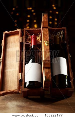 Beautiful wooden case with wine bottle on unfocused background