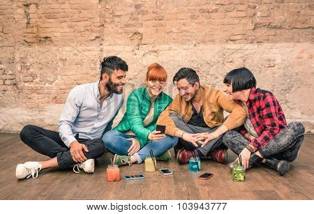 Group Of Hipster Best Friends With Smartphones In Grungy Alternative Location - Young Entrepreneurs