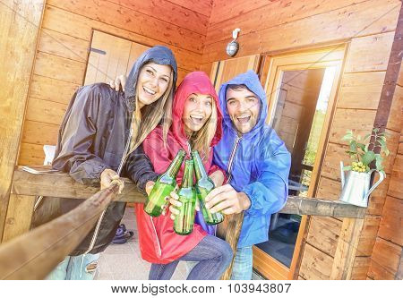 Best Friends Taking Tilted Selfie At Camping Bungalow With Sunshine After The Rain - Youth And Fun