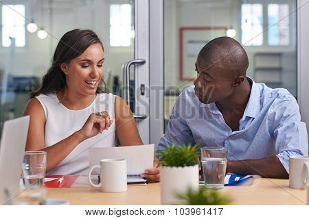 Black African businessman reviewing business proposal in boardroom meeting poster