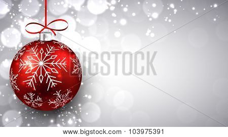 Silver defocused background with red christmas bauble and place for text. Vector.