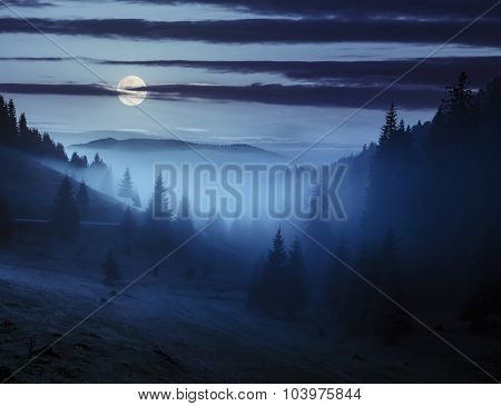 Fog Around The Mountain Top At Night