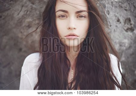 Outdoors portrait of beautiful romantic lady with magnificent hair