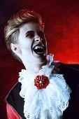 Handsome bloodthirsty vampire. Halloween. Dracula costume. poster