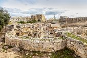 Hagar Qim, ancient Megalithic Temple of Malta, is a unesco world heritage site on the island nation of Malta. poster