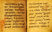 vintage background-old book open on both shabby pages with text on slavonic. paper with stains and scratches. poster