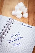 Inscription World diabetes day in notebook and sugar cubes symbol of diabetic and fight against diabetes poster