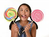 happy female child wearing dress holding two big lollipop in crazy funny face expression in sugar addiction and kid love for sweet candy concept isolated on white background poster