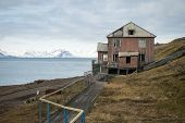 Abandoned houses in Barentsburg Russian settlement in Svalbard Norway poster