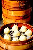 Chinese Dim sum dumplings food on display in Shanghai China. poster