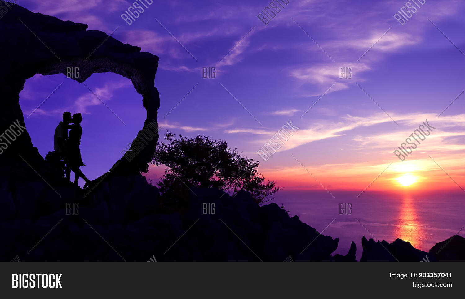 Silhouette Valentine Background Concept Kissing In A Heart Shaped Stone On Mountain With