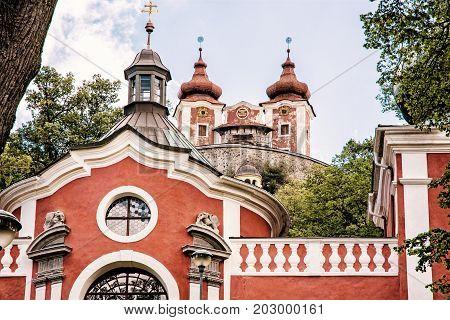 Calvary in old mining town Banska Stiavnica Slovak republic. Religious architecture. Travel destination. Retro photo filter.