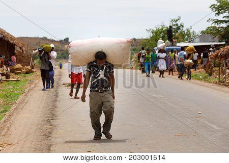 Malagasy Man Transport Cargo On Head