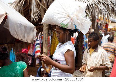 Malagasy Woman Transport Cargo On Head