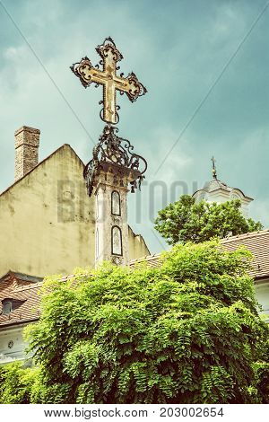 Detail of holy cross in Szentendre Hungary. Religious architecture. Place of worship. Symbolic object. Beauty photo filter.