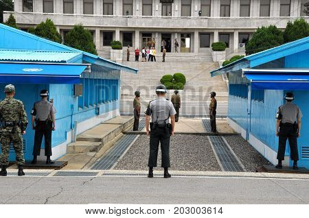 PANMUNJOM, SOUTH KOREA - SEPTEMBER 26, 2014: Korean soldiers watching border between South and North Korea in the Joint Security Area (DMZ) on September 26, 2014 in Panmunjom, South Korea.