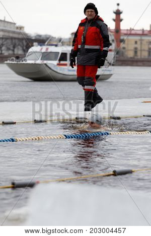 ST. PETERSBURG, RUSSIA - MARCH 18, 2017: People participate in the winter swimming competitions in river Neva. The event aimed to revive the winter swimming tradition dated back to 1960-1990s
