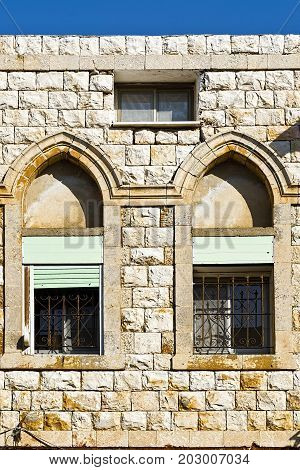 Windows of traditional stoned house in old Acre. Arab architecture of the old city of Akko in Israel.