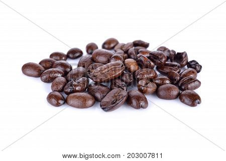 pile of roasted coffee beans arabica strong blend on white background