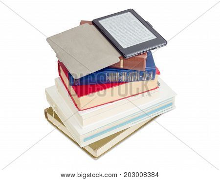 Ebook reader in an open case on a stack of ordinary paper books on a white background