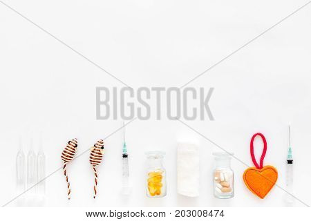 cure tools for pet cat and dog and toys for treatment in grooming set on white desk background top view mock-up