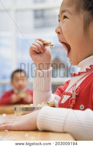 Chinese girl eating