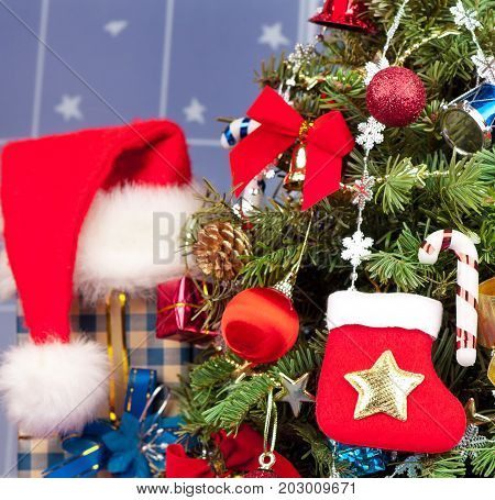 Christmas toy balls with garland over presents and christmas spruce background