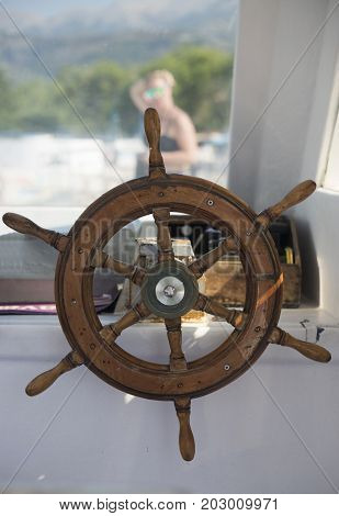 Ship's wheel on a sea boat close-up
