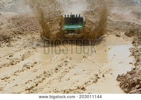 land vehicle in muds & 4x4 off road position