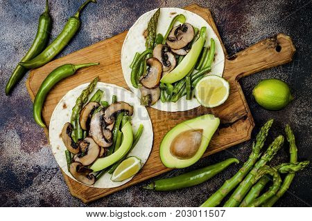 Grilled portobello asparagus bell peppers green beans fajitas. Poblano mushroom tacos with jalapeno cilantro avocado crema. Vegan tacos with green summer vegetables.