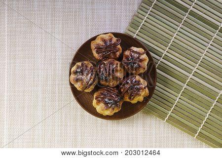 Chocolate cream puff on wooden background. .