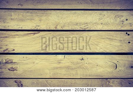 grunge rotting pale wood plank texture background in vintage filter.