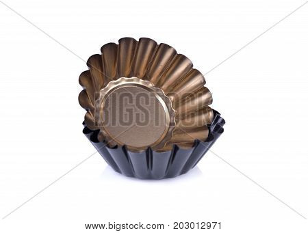 gold and black mini tart tins on white background