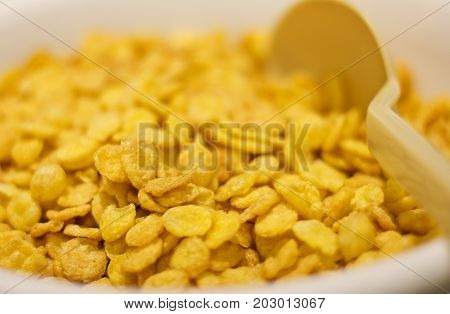 Corn Flakes With Spoon For Breakfast. Selective Focus. Macro