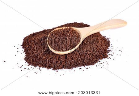 ground coffee arabica strong blend in wooden spoon and on white background
