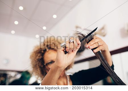 Female Hair Stylist Cutting Woman 's Hair At Salon