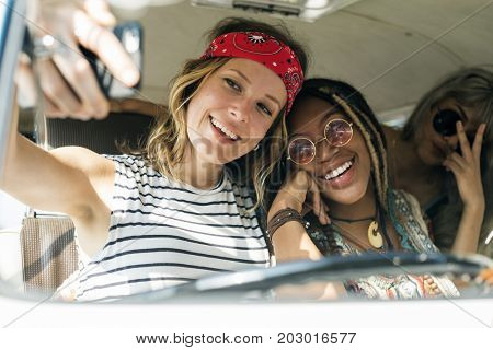 Group of Diverse Friends on Road Trip Taking Selfie Together