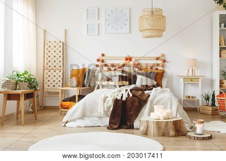 Messy king-size bed with warm blankets in the bedroom