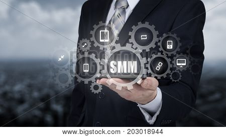 Business, technology, internet and networking concept. SMM - Social Media Marketing on the virtual display.