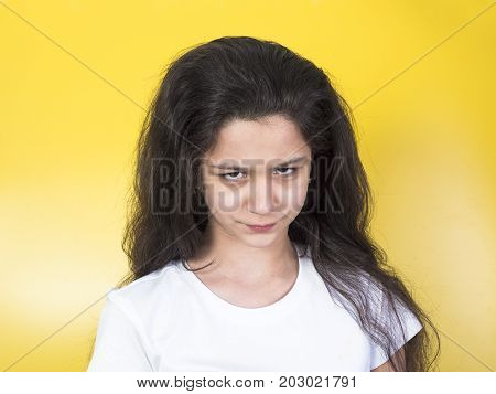 Angry Young Girl Looking At Camera With Hate
