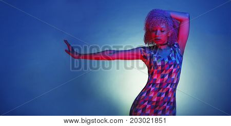 isolated black woman with a retro style from the eighties with a groovy afro hair