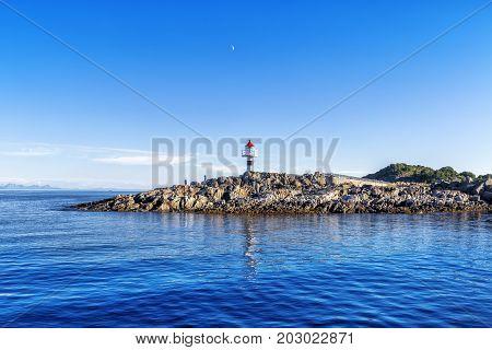 Lighthouse On The Trollfjord (trollfjorden) In The Lofoten Islands