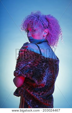 black woman from the eighties on groovy clothes and neon lights