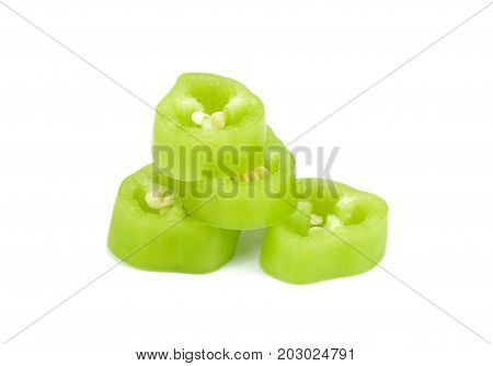 cut green hot chili peppers capsicum on a white background